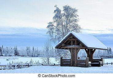 Log Pavilion in Alaska during the Winter