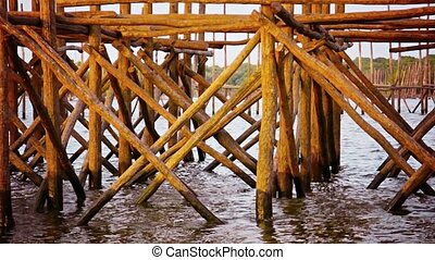 Log Piers and Structural Supports comprise a Local Fishing...