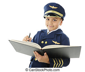 """Close-up image of a handsome elementary """"airline pilot"""" signing the pilot's log book. On a white background."""
