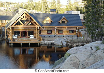 loghouse - Log cabin on lake in forest