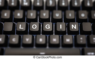 Login online concept. Login text written on keypad. Black keys with white letters message for identification and access on pc keyboard. Blur buttons background.