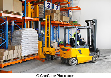 Logistic - Two yellow forklift vehicles in distribution...