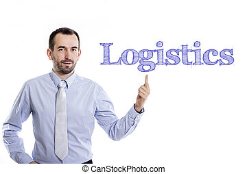 Logistics - Young businessman with small beard pointing up in blue shirt