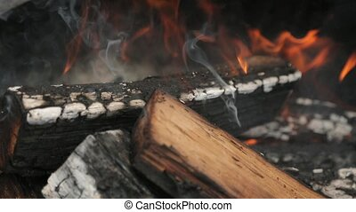 Logs smoldering in the fire in the barbecue