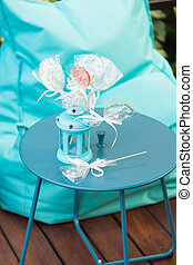 Lollypops in lantern on the table