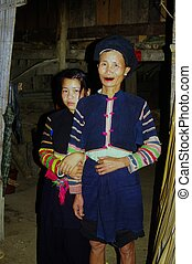 Lolo tribe mother and her daughter outside the house