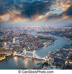 London. Aerial view of Tower Bridge at dusk with beautiful...