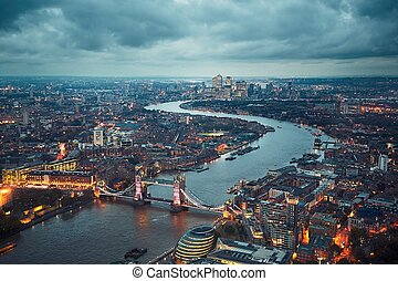 London at the dusk - London skyline with illuminated Tower...