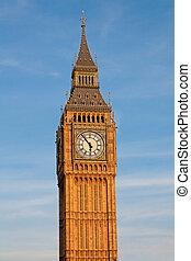 Famous Big Ben clock tower under direct sunset light. London, UK.