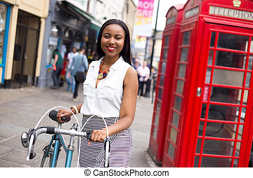 london bike - young woman in London with a bicycle