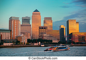 Canary Wharf business district in London at sunset.