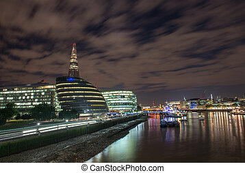 London Cityscape, including City Hall and River Thames at Night, seen from Tower Bridge - UK