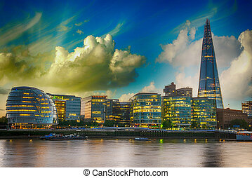 London Cityscape, including City Hall, seen from Tower Bridge at sunset