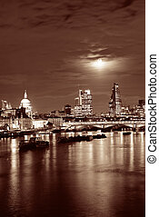 London cityscape with urban buildings and moon over Thames...