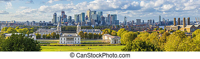 London, England, Panoramic Skyline View Of Greenwich College and Canary Wharf At Golden Hour Sunset With Blue Sky And Clouds