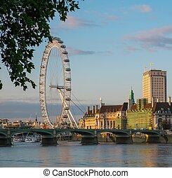 London Eye on Thames river at sunset