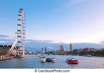 London Eye with Big Ben at dusk - LONDON - April 14: London...