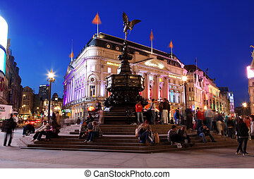 LONDON - JUN 8: Famous crossroad Piccadilly Circus night...