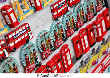 LONDON - JUNE 7: Few rows of magnet souvenirs from London: Big Ben, red bus, phone on June 7, 2010 in London. Annually visitors spend in London 10 billion pounds sterling
