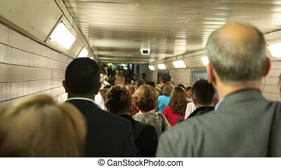 Very many people are going in  metro past each or