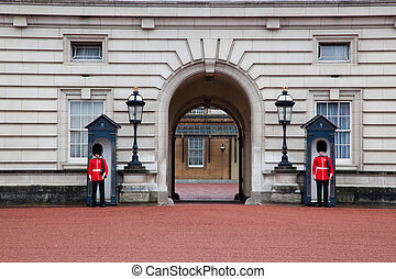 LONDON - MAY 17: British Royal guards guard the entrance to...