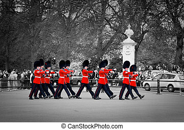 LONDON - MAY 17: British Royal guards march and perform the Changing of the Guard in Buckingham Palace on May 17, 2013 in London, UK