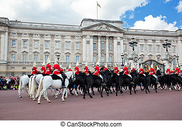 LONDON - MAY 17: British Royal guards riding on horse and perform the Changing of the Guard in Buckingham Palace