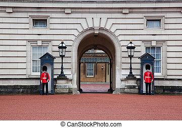 LONDON - MAY 17: British Royal guards guard the entrance to...