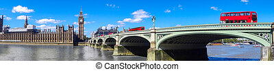 London panorama with red buses on bridge against Big Ben in...
