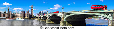 London panorama with red buses on bridge against Big Ben in England, UK