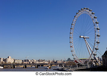 london - the london eye and the thames river in london