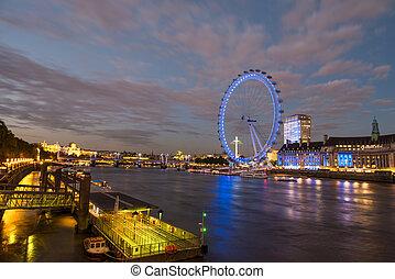 London Skyline at dusk from Westminster Bridge with illuminated London Eye - UK