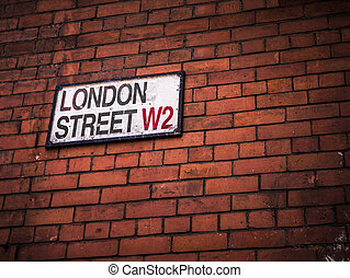 London Street Sign On A Red Brick Wall