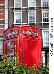London symbol red phone box residential district background