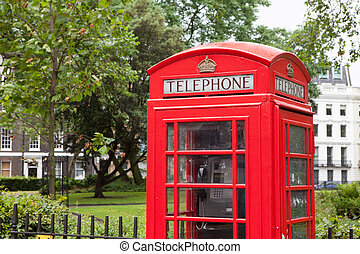 London symbol red phone box residential district background...