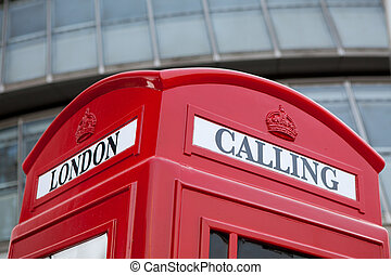 London symbol red public phone box on facade background