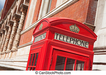 London symbol red telephone box on building facade background
