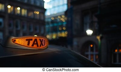 Looping Orange Taxi Light Switching On Then Off In A London Street At Twilight