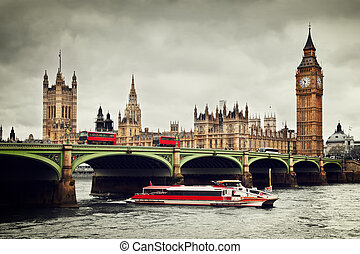 London, the UK. Big Ben, the River Thames, red buses and boat in vintage style