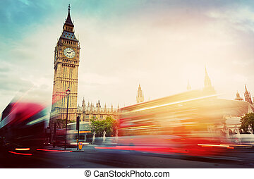 London, the UK. Red buses and Big Ben, the Palace of Westminster. Vintage