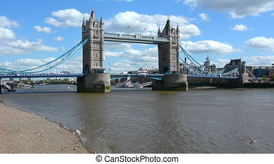 Panoramic view of The Tower Bridge spanning over River Thames as view from London borough of Tower Hamlets (north side) in London, UK.