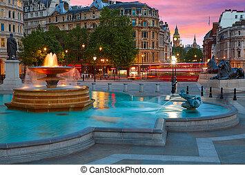 London Trafalgar Square fountain at sunset