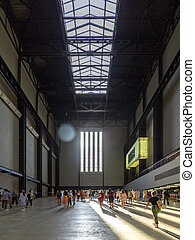 LONDON, UK - AUGUST 2, 2018: Visitors in the interior of famous Tate Modern art gallery