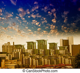 London, UK. City buildings seen from St George Wharf Riverside Walk.