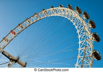 LONDON, UK - JANUARY 2, 2015: View of the London Eye. London Eye (135 m tall, diameter of 120 m) - a famous tourist attraction over river Thames
