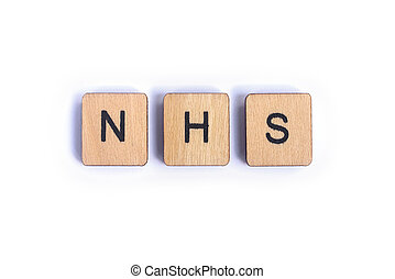 LONDON, UK - JULY 7TH 2018: The abbreviation NHS - National Health Service - spelt with wooden letter Scrabble tiles, on 7th July 2018.