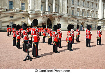 LONDON, UK - JUNE 12, 2014: British Royal guards perform the...
