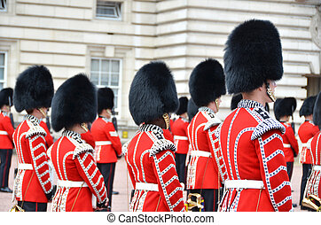 LONDON, UK ? JUNE 12, 2014: British Royal guards perform the Changing of the Guard in Buckingham Palace