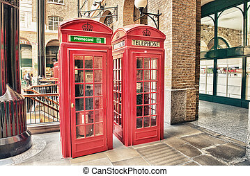London, UK. Old Red Telephone Booth on a city street
