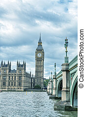 London, UK - Palace of Westminster (Houses of Parliament) with Big Ben clock tower and Westminster bridge over Thames river.